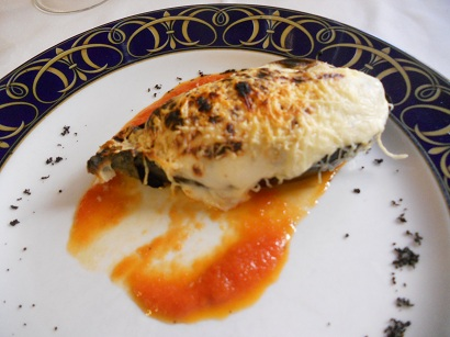 Aubergine stuffed with seafood with a cheese topping